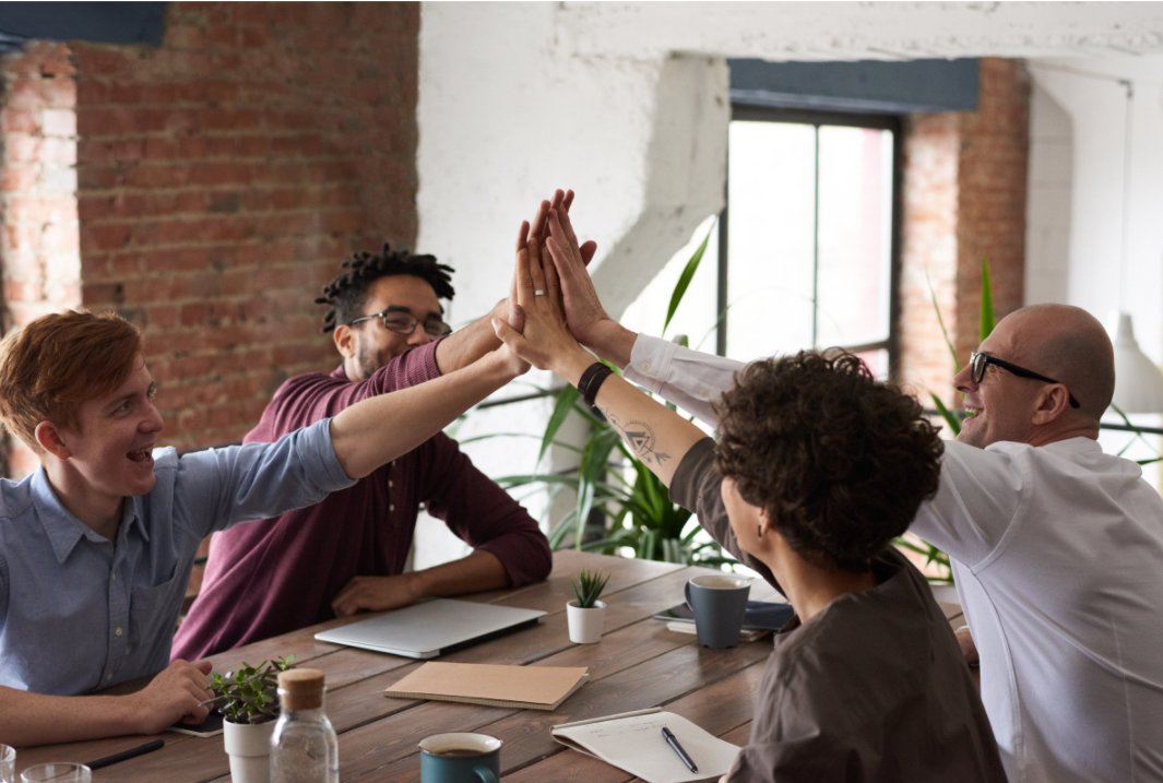 Colleagues high fiving, returning to work Bright PUrple