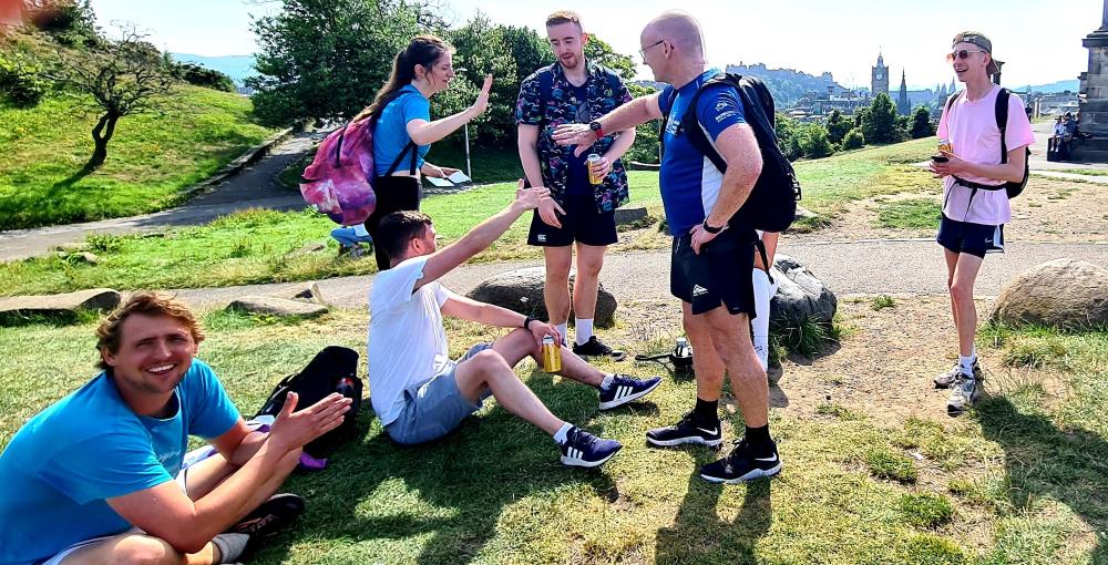 Calton Hill high fives Bright PUrple Edinburgh 7 Hills Challenge